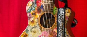 colourful six stringed guitar with red background