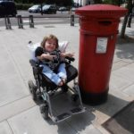 Claire posing next to a red london letterbox